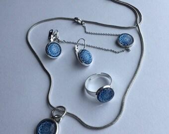 Blue Polaris Carbochon Schmuckstet in the mandala design