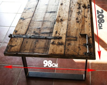 Table handmade rustic industrial style with old wood of a door  age 1800s of a  Austro-Hungarian barracks military  Venetian Italian style