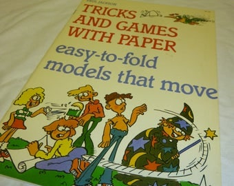 Tricks and Games with Paper - Easy to Fold Models that Move