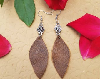 Leather Leaf Shaped Earrings Dangling From A Silver Colored Rose.