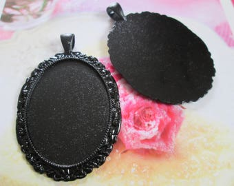 a black Medallion oval backing for 40 x 30 mm cabochons