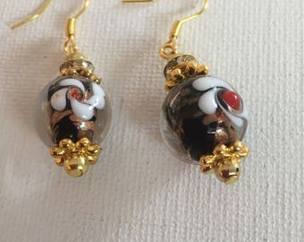 White and black dangle earrings. Dangle earrings. Drop earrings. Multi colored dangle earrings with gold trim.