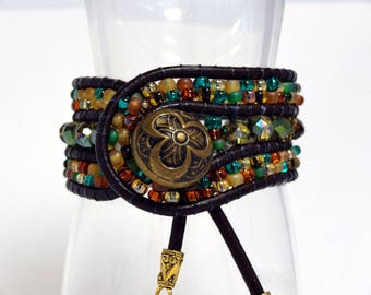 Fall colors wrap bracelet with vintage brass button, gold acorn and leaf charms