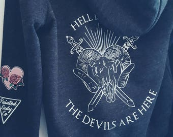 The devil's are here women's hoodie