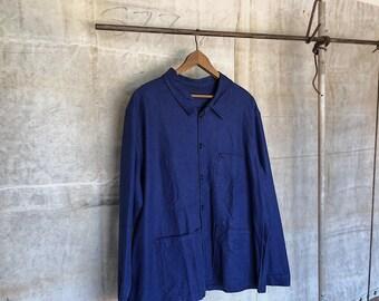 Vintage French workwear canvas chore jacket.
