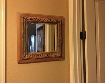 saguaro rib mirror and cholla cactus on cedar frame