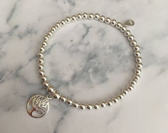 Sterling Silver stretch bracelet with Circle Tree of Life charm