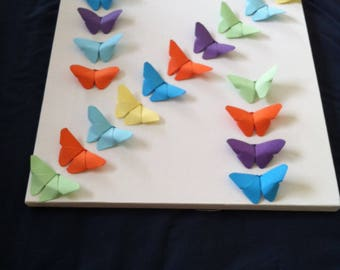 Origami butterflies on canvas