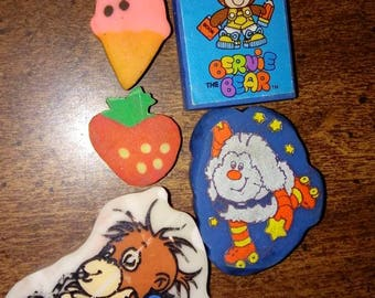 Vintage erasers, lot of five: extremely rare Bogey the Orangutan, Rainbow Brite Sprite, Bernie the Bear, ice cream cone, strawberry, 1980s