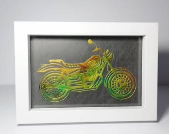 Picture of motorbike on a background painted using alcohol inks.
