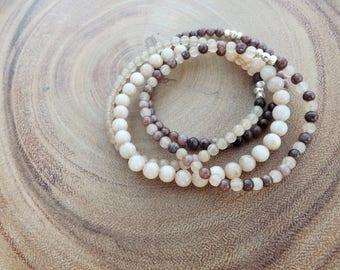 Quartz-mauve and cream color beaded bracelets