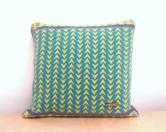 Snuggly and bright lambswool cushion