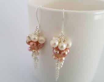 Long pearl earrings, dangle, wire wrapped in silver plate.