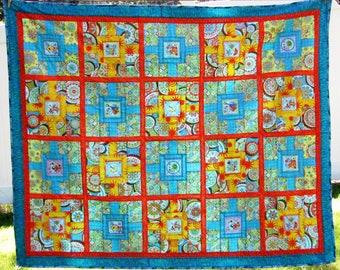 Beautiful handmade junior-sized quilt in turquoise, yellow and orange, bright and cheery!