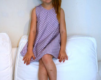 Purple trapeze dress with small white flower from 4 to 6 years