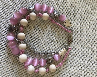 """Rose pink and cream colored beaded multi strand bracelet.  8"""""""