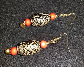 Gold Black and Red Beads with Goldtone Bell Charm