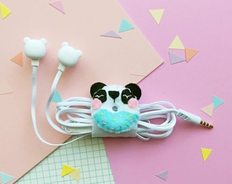 Panda donut earphone organizer with headphones, iphone earbuds, samsung earpods, phone accessories