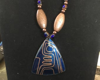 Blue and copper beaded necklace with a pendant and matching earrings