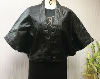 Absolutely crazy cool 80's black leather, shawl collar batwing cape jacket.