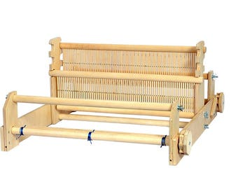 Rigid heddle loom with two heddles