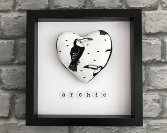Personalised monochrome toucan heart picture.