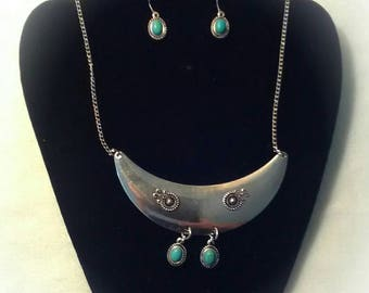 This one of a kind set includes faux turquoise stones