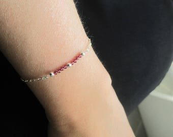 Delicate sterling silver bracelet and its Ruby - minimalist Garnet gemstones.