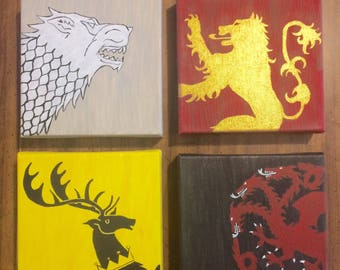 Game of Thrones house sigils on canvases