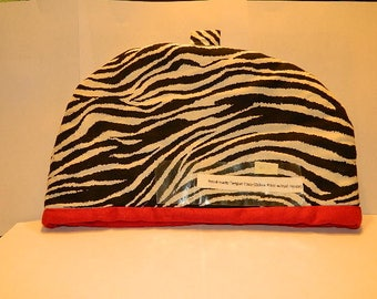 Zebra Tea Cozy with red on the inside