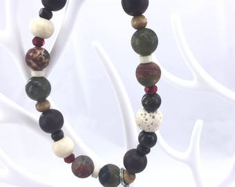 Gorgeous Lava Bead Bracelet with a cross Charm