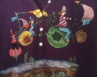 """Travel"" on purple t-shirt, long sleeves, size 1"