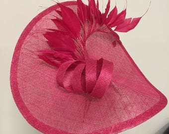 Stunning Fushia fascinator with feathers and bow, perfect for races, weddings or any special occassion