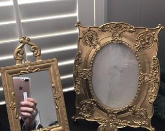 beautiful antique bronze standing mirror