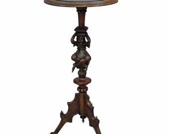 a great antique guéridon with jester base