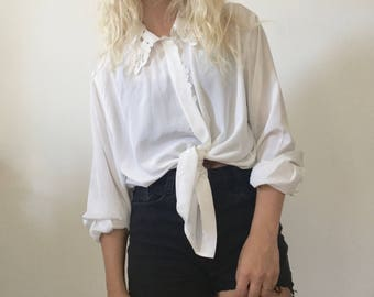 White shirt with embroidery details