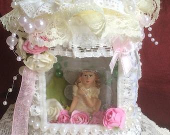 Beautiful captured fairy, fairy in a jar.