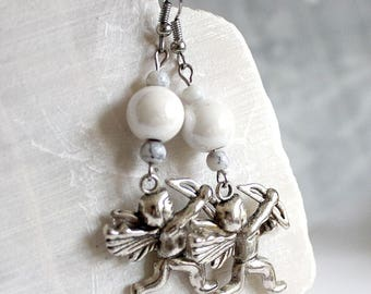 Cupid earrings and off white ceramic