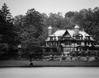 Large black and white picture of a castle on the lake Finger Lakes Skaneateles lake misty morning
