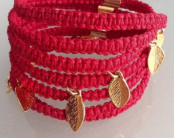 Red knitted bracelet with leaves, macrame