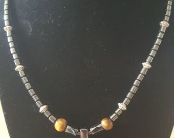 Hematite cross pendant with Tigers eye