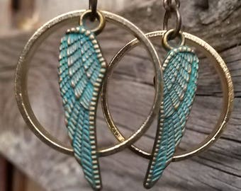 Wing and ring handmade earrings