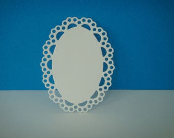 Small oval cut with ornaments in white foam for creation (rubber only)