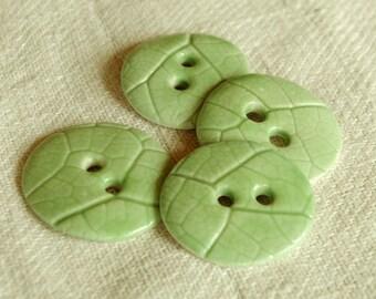 Set of 4 porcelain buttons green semi gloss