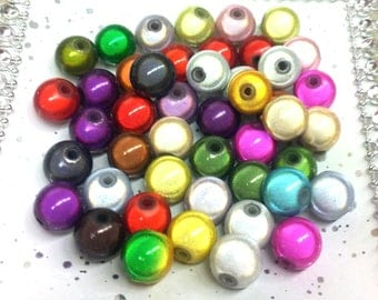 Set of 20 round magic beads multicolor 8 mm T25