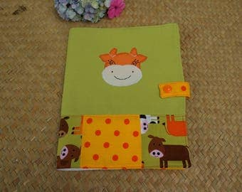 Health booklet protection cover patchwork with happy cows in the meadows