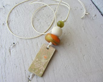 Necklace pendant ceramic handcrafted, polymer clay, natural wood and glass bead in orange, ecru and olive green cat's eye