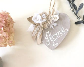 "Fretwork wooden heart painted in taupe, decorated with fabric and felt flowers. Calligraphy ""home"""