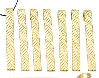 Set of ten ± 40 decorated metal pendants/charms x 4, 5mm (eye ± 4mm)