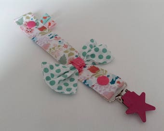 Pacifier in floral fabric and little green bow with snap and clip type strap fuschia star